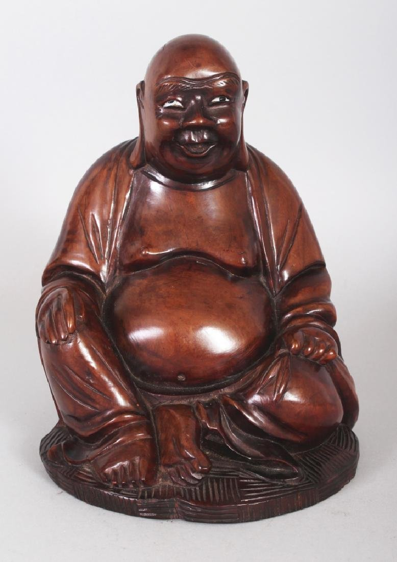 A CHINESE CARVED HARDWOOD FIGURE OF BUDAI, 8.2in high.