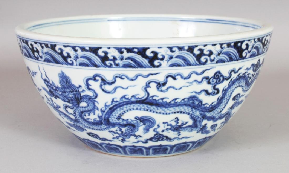 A CHINESE MING STYLE BLUE & WHITE DEEP PORCELAIN DRAGON