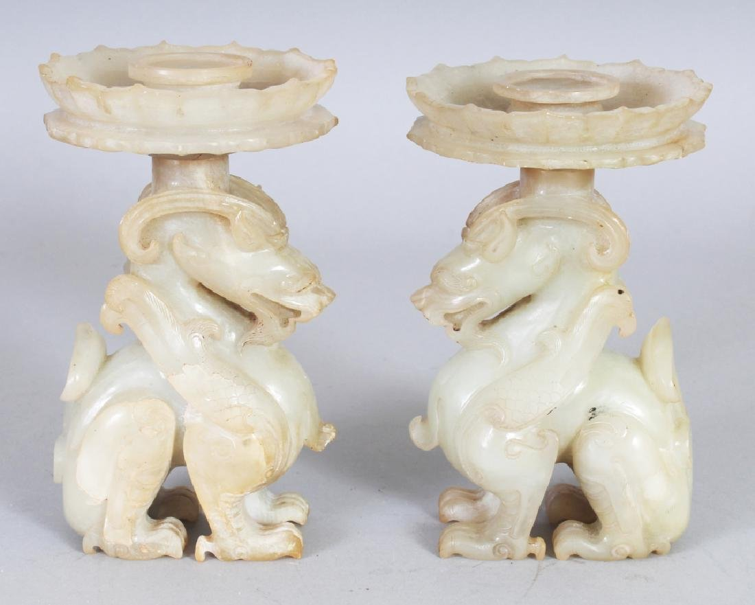A PAIR OF CHINESE PALE CELADON JADE CANDLESTICKS, each
