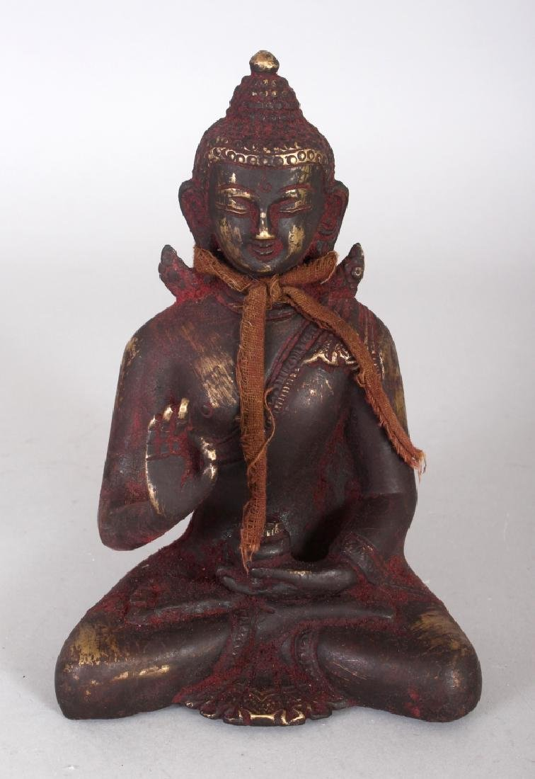 A CHINESE GILT BRONZE FIGURE OF BUDDHA, seated in
