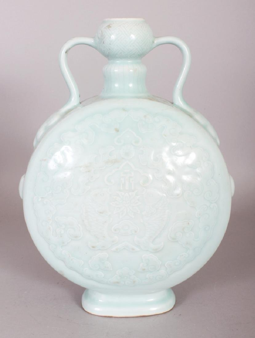 A CHINESE CELADON MOULDED PORCELAIN MOON FLASK, the