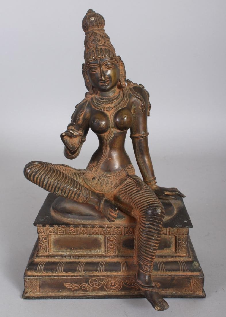 A 19TH INDIAN BRONZE FIGURE OF PARVATI, seated in