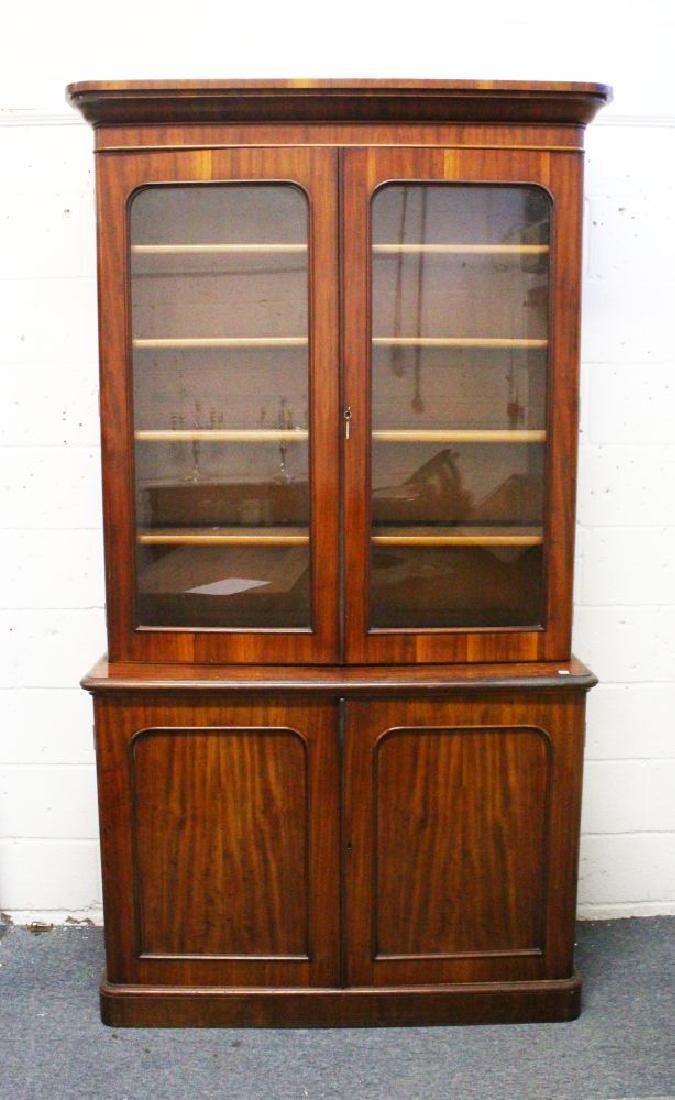 A VICTORIAN MAHOGANY CUPBOARD BOOKCASE, with a moulded