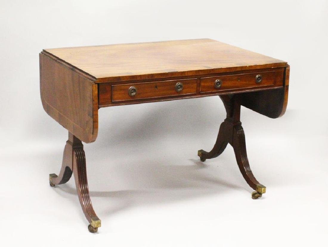 A REGENCY MAHOGANY AND ROSEWOOD CROSSBANDED SOFA TABLE,