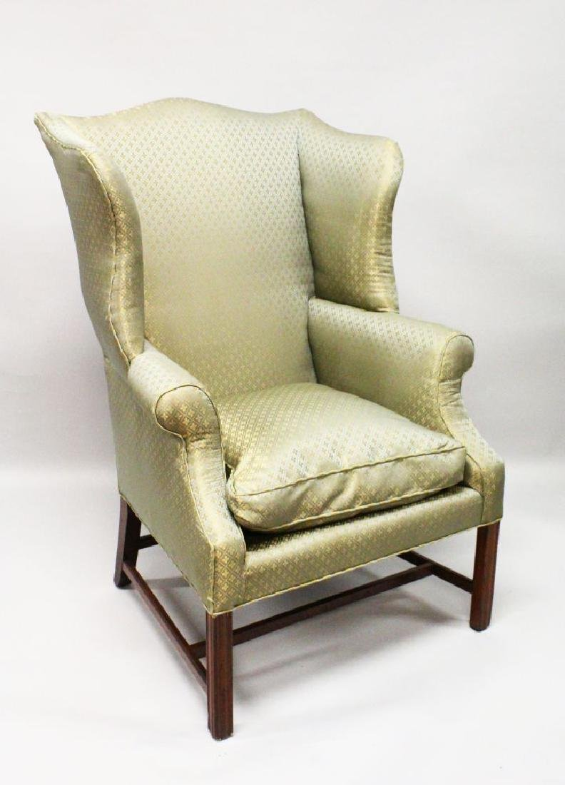 A GEORGE III DESIGN MAHOGANY WING ARMCHAIR, with padded