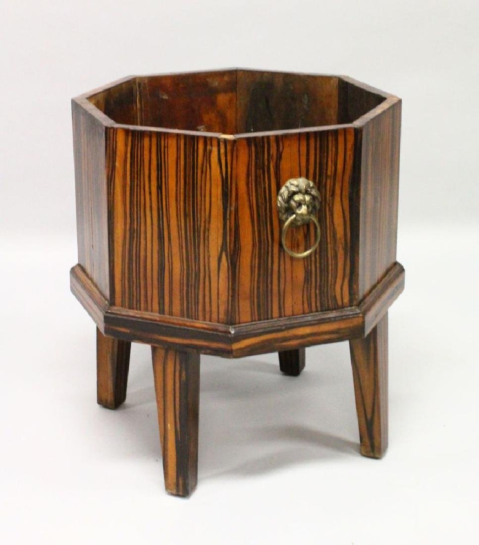 A COROMANDEL OCTAGONAL WINE COOLER with lion ring
