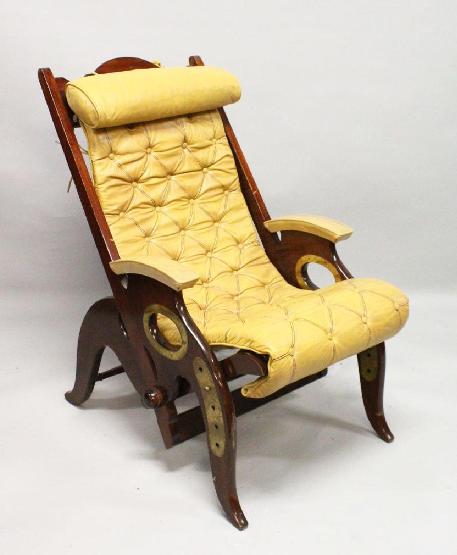 AN UNUSUAL MAHOGANY AND BRASS RECLINING CHAIR with