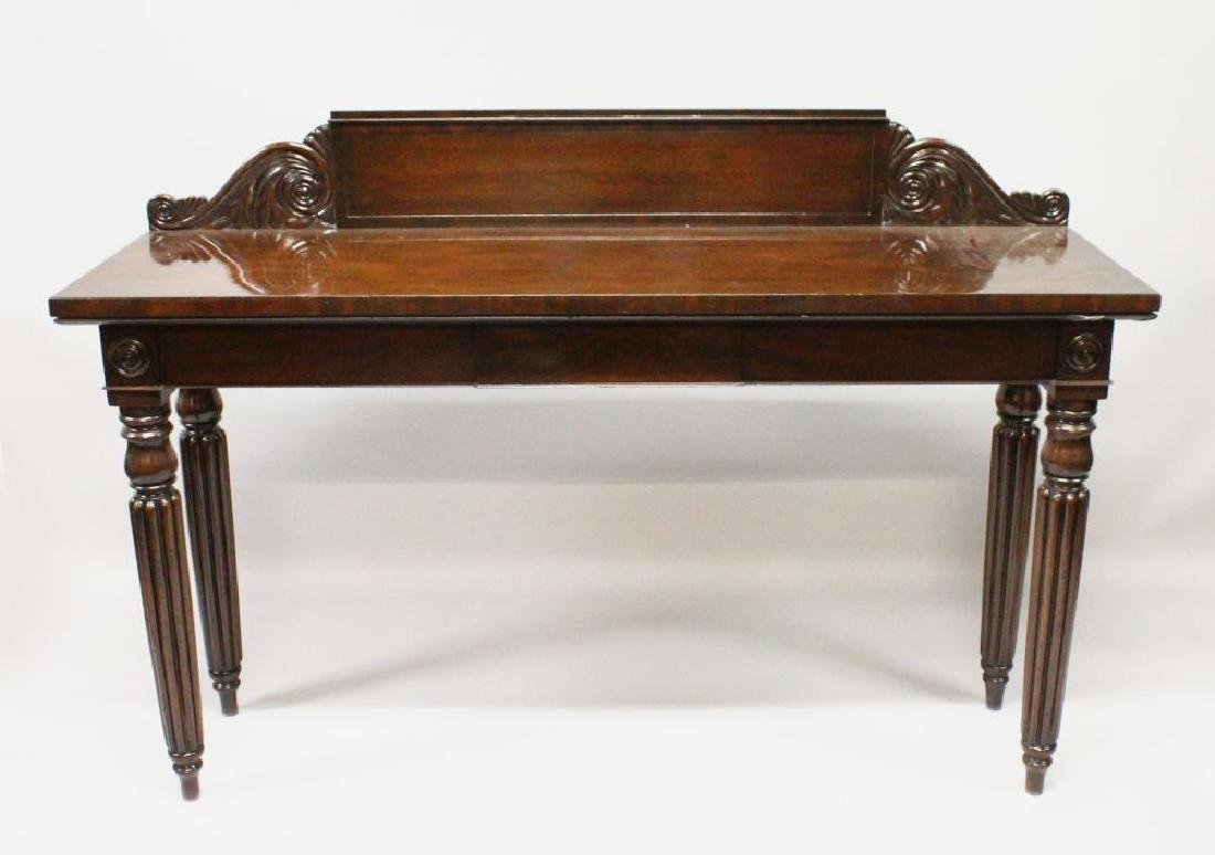 A LATE REGENCY MAHOGANY LONG SERVING TABLE, with shaped