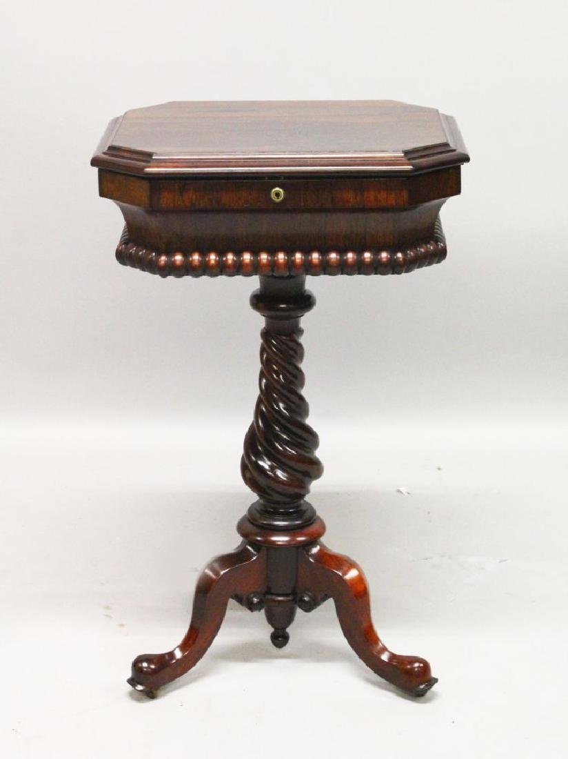 A LATE REGENCY ROSEWOOD SEWING BOX on stand, with