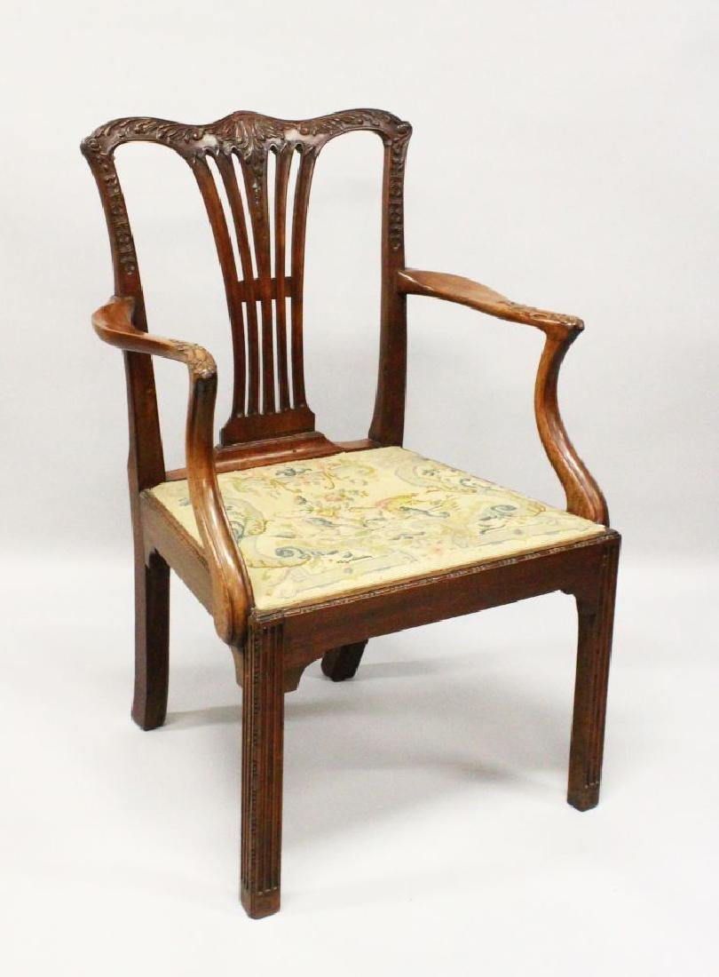 A CHIPPENDALE MAHOGANY ARMCHAIR, with carved cresting