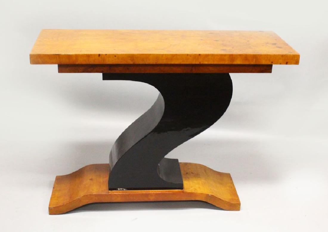 AN ART DECO DESIGN CONSOLE TABLE, with curving ebonised