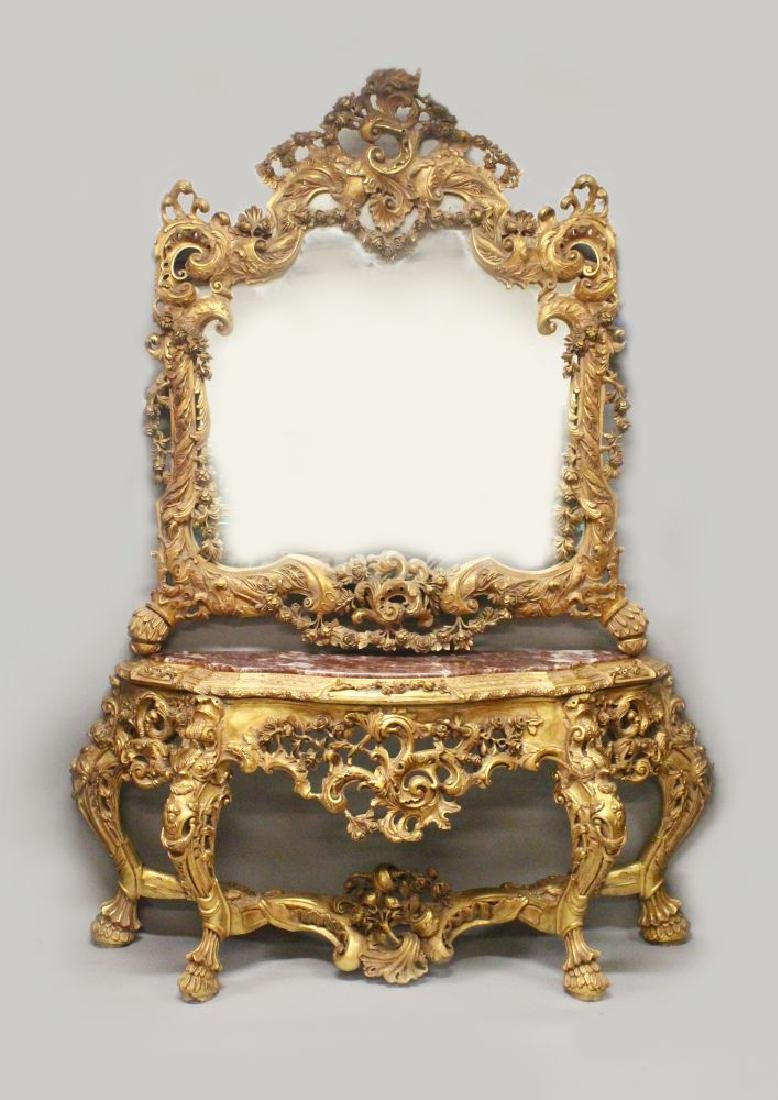 AN IMPRESSIVE ITALIAN ROCOCO STYLE GILTWOOD AND MARBLE