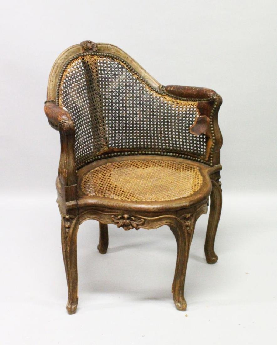 AN 18TH CENTURY FRENCH WALNUT CANE CORNER CHAIR.