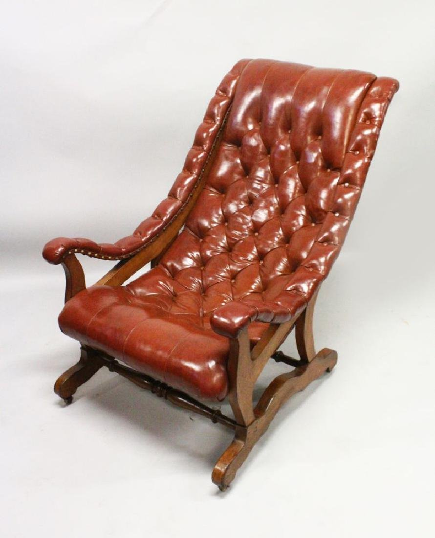 A GOOD BUTTON UPHOLSTERED AND MAHOGANY FRAMED ARMCHAIR.