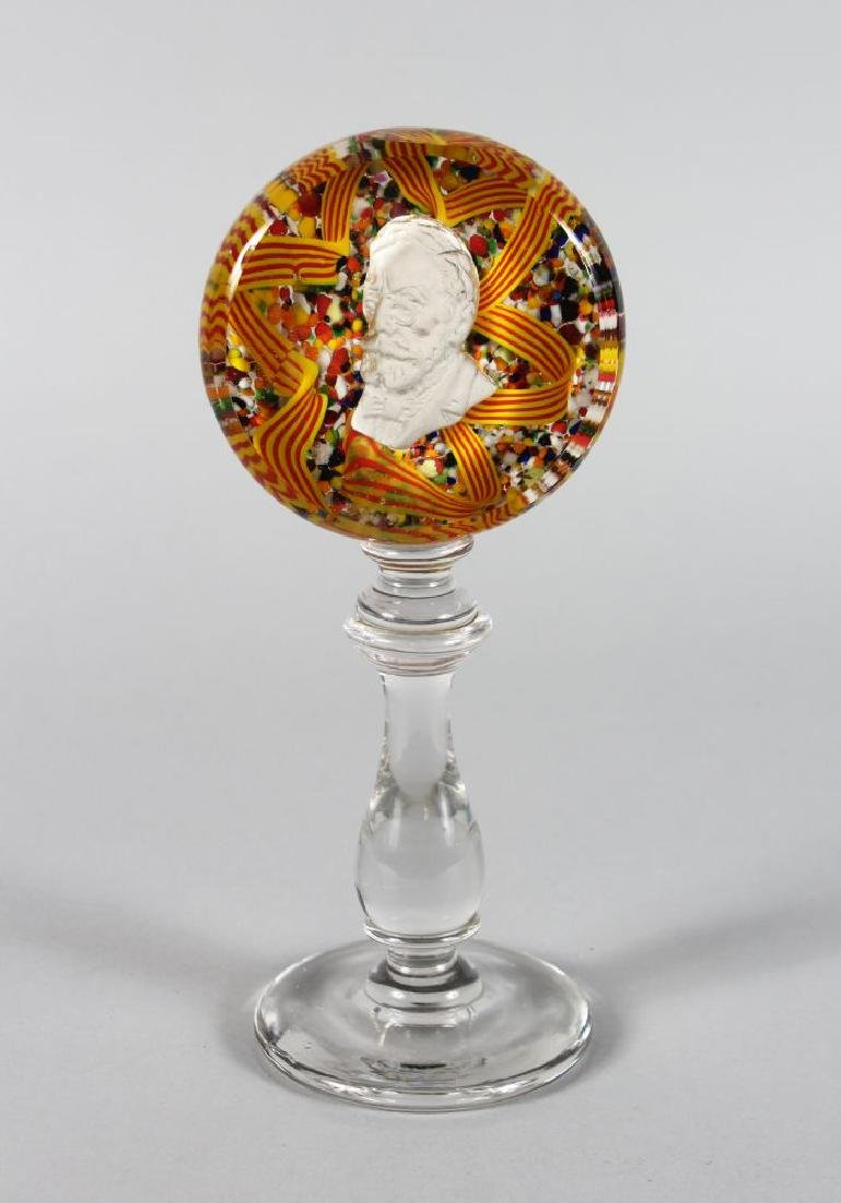 A MILLEFIORI CIRCULAR PEDESTAL PAPERWEIGHT inset with a