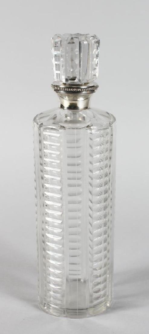 A TALL CUT CIRCULAR DECANTER AND STOPPER with silver