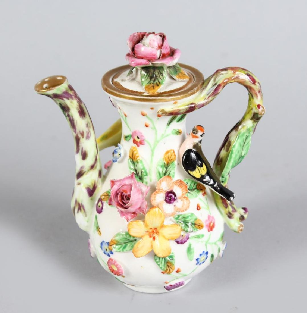A MINIATURE SPODE FLOWER AND BIRD ENCRUSTED WATERING