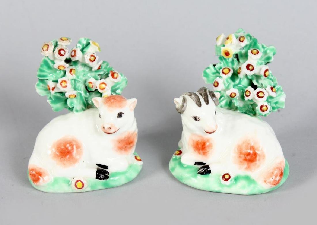 A PAIR OF MINIATURE DERBY RAM AND EWE BROCAGE FIGURES,
