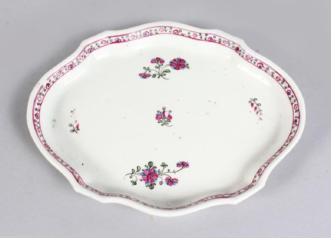 A NEWHALL SHAPED TEAPOT STAND, sprigged with flowers.