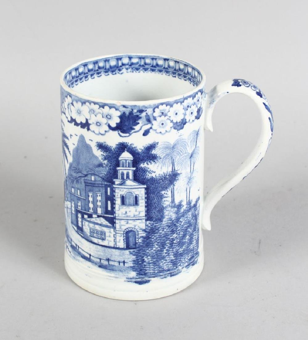 AN 18TH CENTURY ENGLISH POTTERY BLUE AND WHITE TANKARD,
