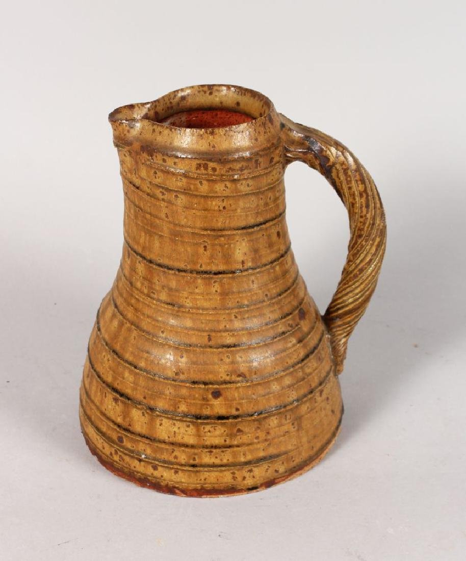A LARGE STUDIO POTTERY JUG, with rope work handle.