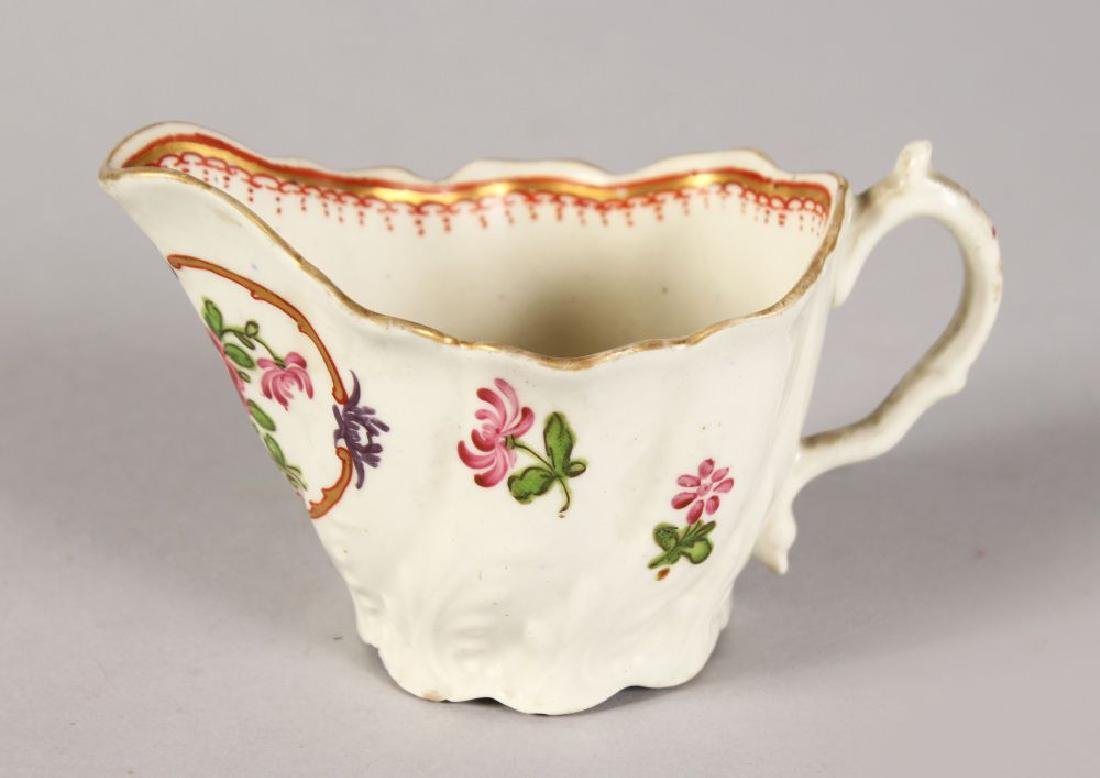 A WORCESTER MOULDED CREAM JUG painted with flowers.