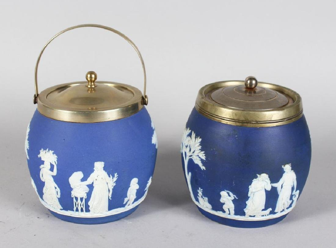 TWO WEDGWOOD BLUE AND WHITE JASPER WARE BISCUIT BARRELS