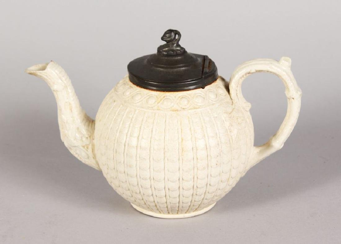 A STONEWARE GLOBULAR TEAPOT with pewter cover.