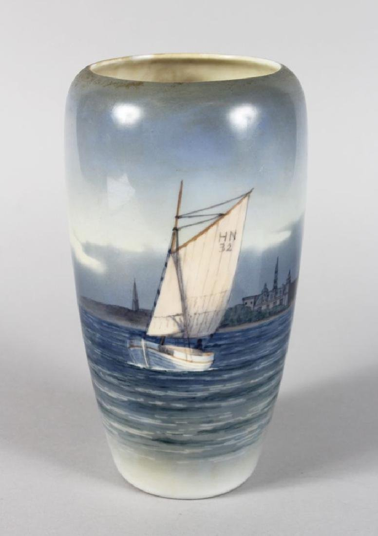 A ROYAL COPENHAGEN VASE, a boat with sail, No. HN32,