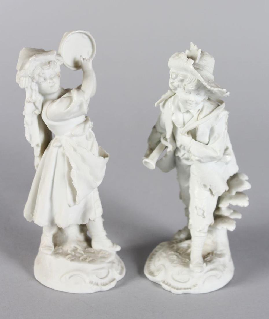 A SMALL PAIR OF CONTINENTAL BISQUE FIGURES, the boy