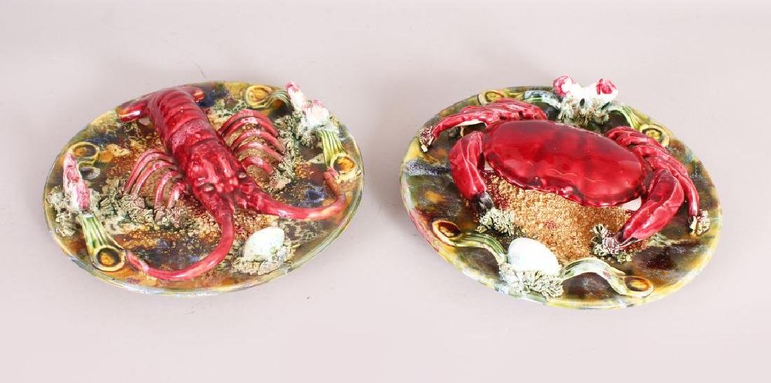 A PAIR OF PALISSY CIRCULAR PLATES, CRAB, LOBSTER, ETC.