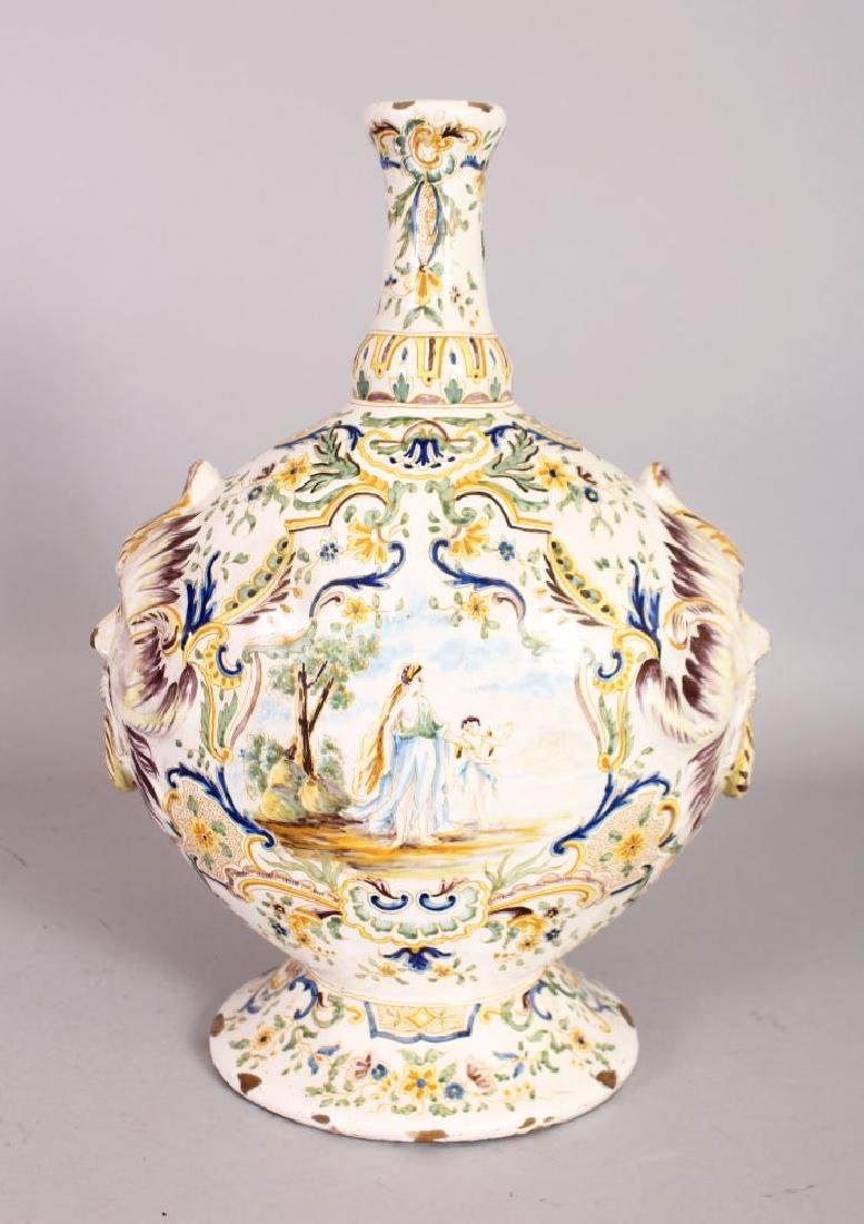 AN 18TH-19TH CENTURY FAIENCE BOTTLE VASE with mask
