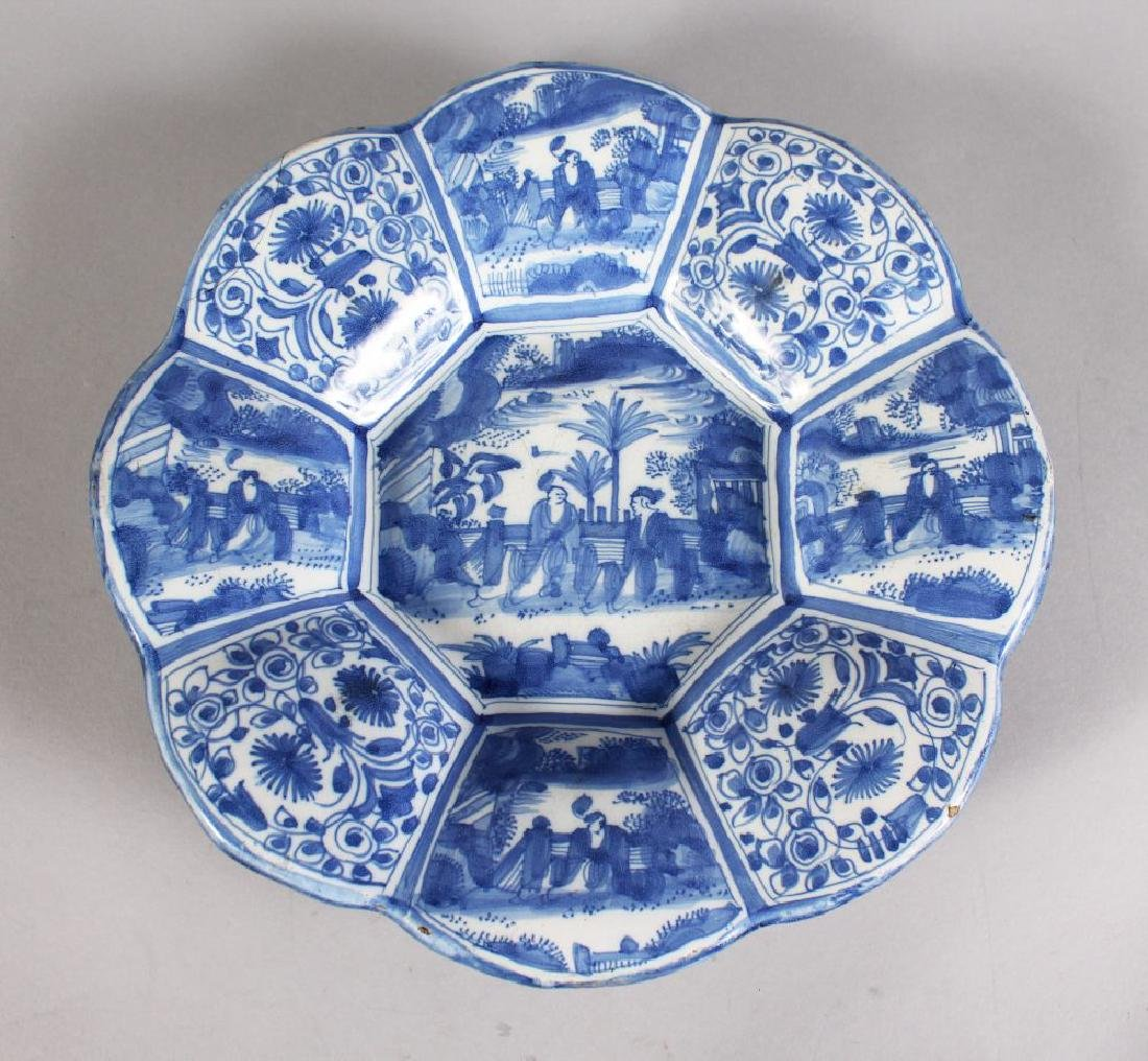 A DUTCH BLUE AND WHITE LOBED CIRCULAR DISH with Chinese