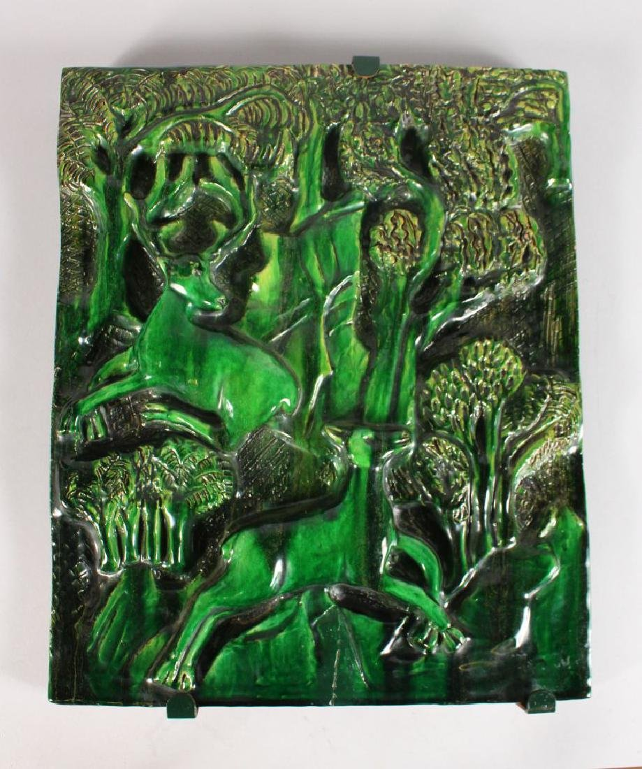 A GREEN ART DECO POTTERY PLAQUE with deer in a
