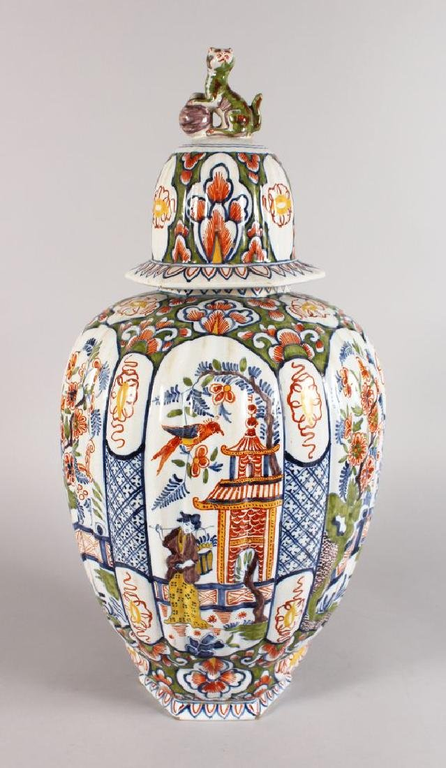 A LARGE POLYCHROME VASE AND COVER, ribbed body with