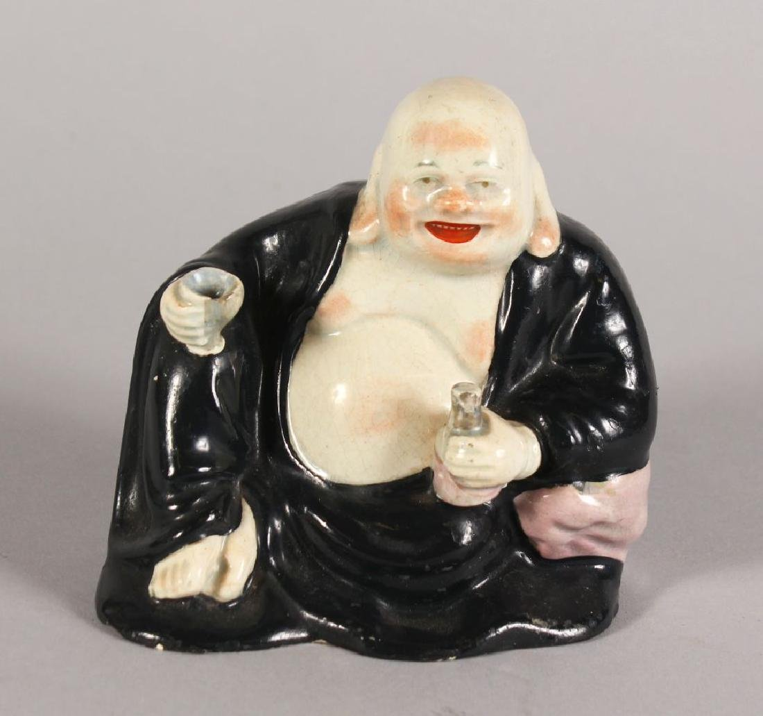 A PORCELAIN FIGURE OF HOTEI.  4.5ins high.