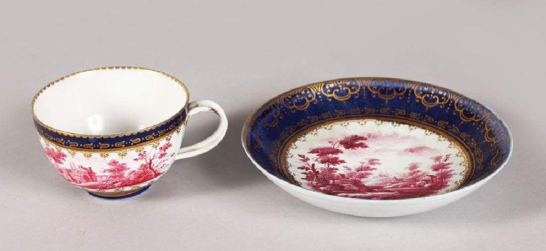 AN 18TH CENTURY DOCCIA TEA CUP AND SAUCER with delicate