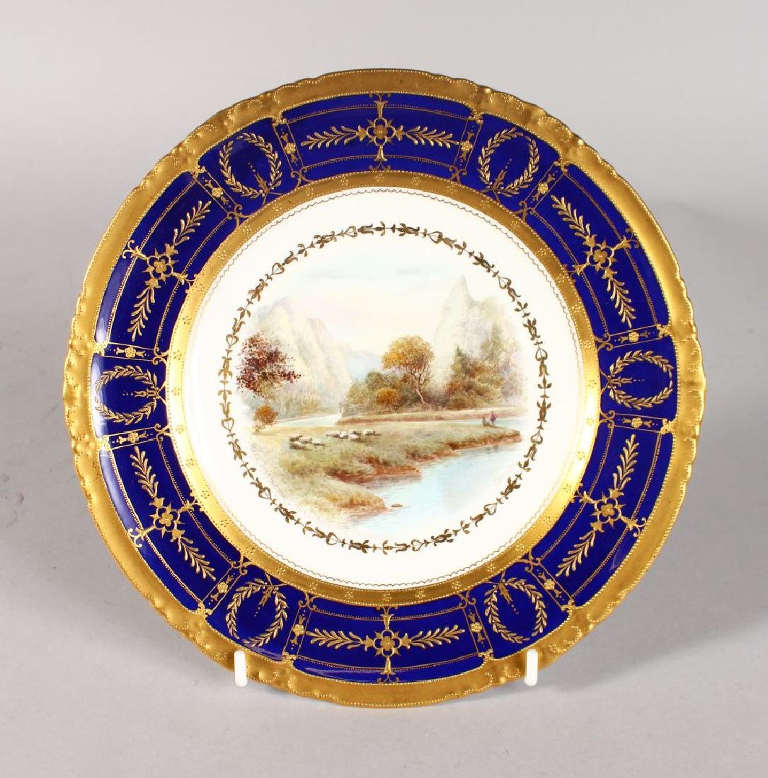 A ROYAL CROWN DERBY PLATE with raised gilt and cobalt
