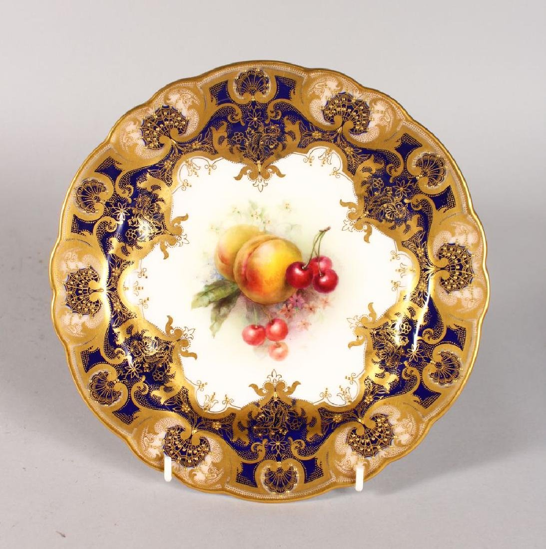 A ROYAL WORCESTER FINE PLATE with cobalt blue border