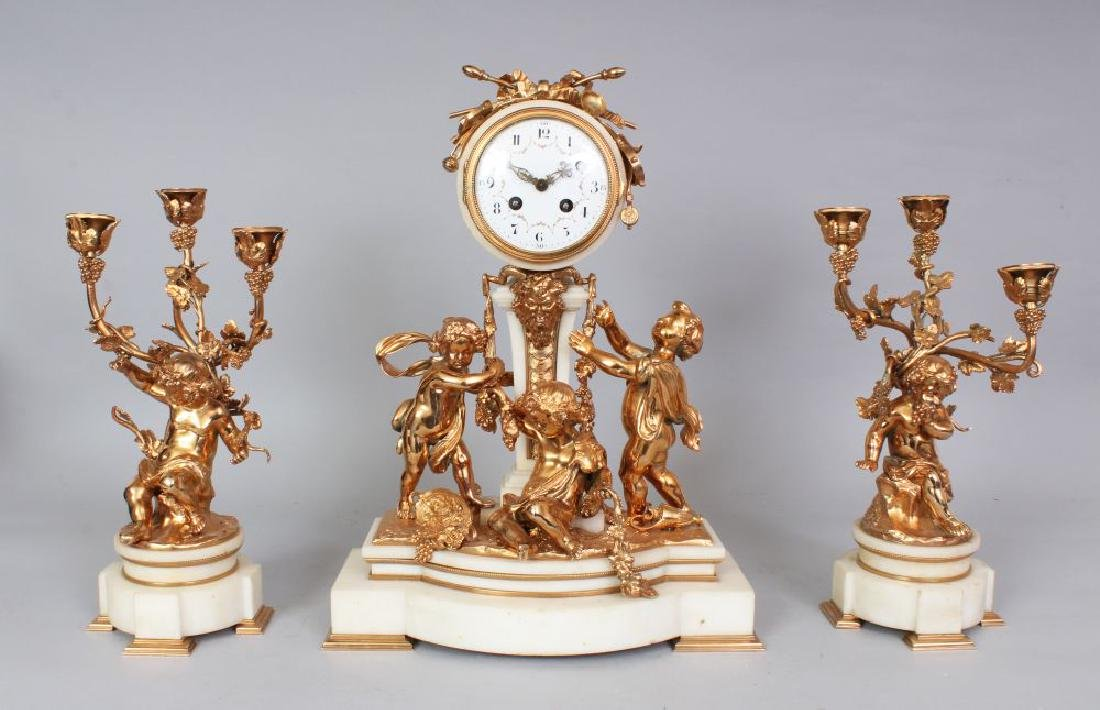 A SUPERB LOUIS XVI BRONZE AND WHITE MARBLE CLOCK