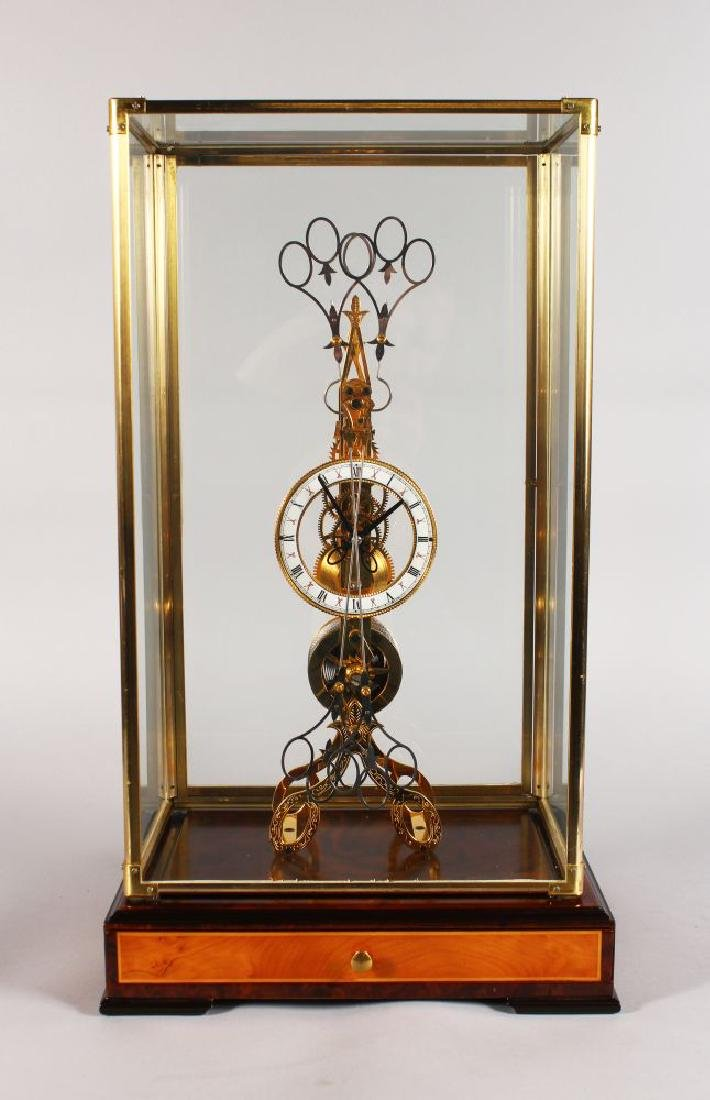 A LARGE SKELETON CLOCK, with white enamel dial and
