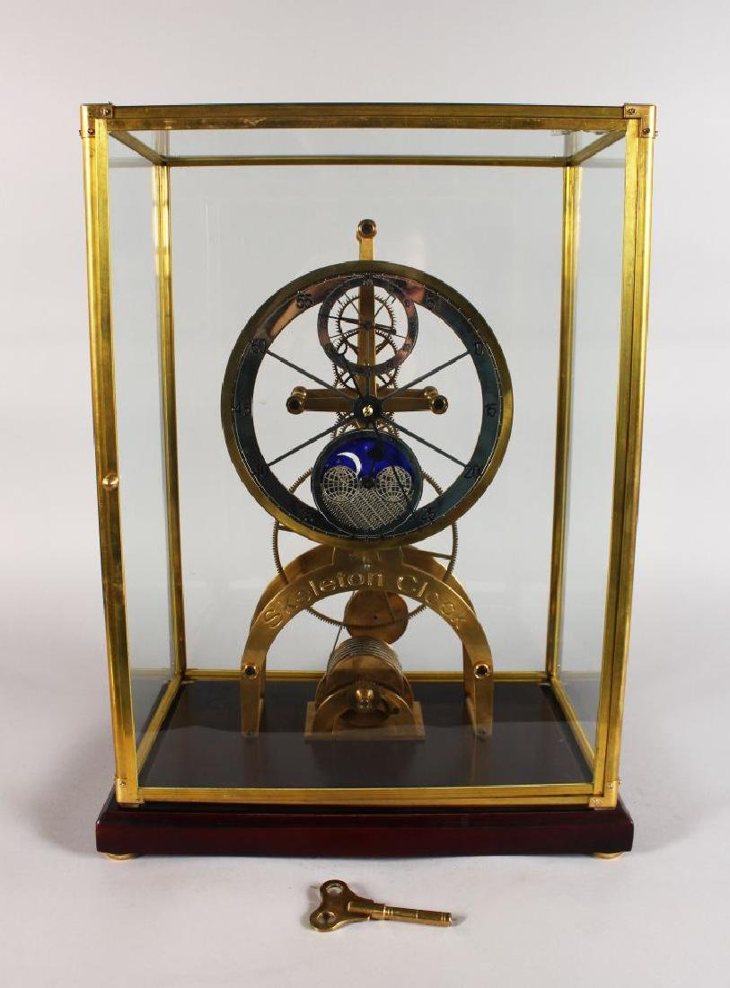 A LARGE SKELETON CLOCK, with silvered dial, subsidiary