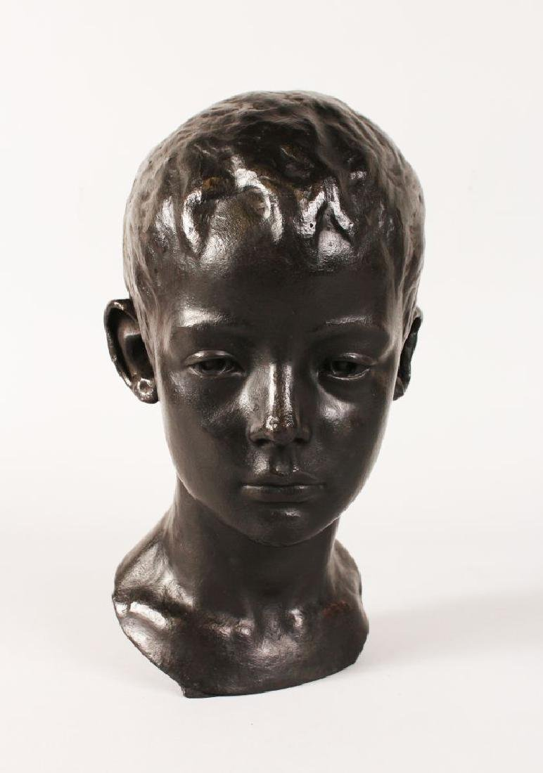 A BRONZE BUST, in memory of a small boy lost at sea