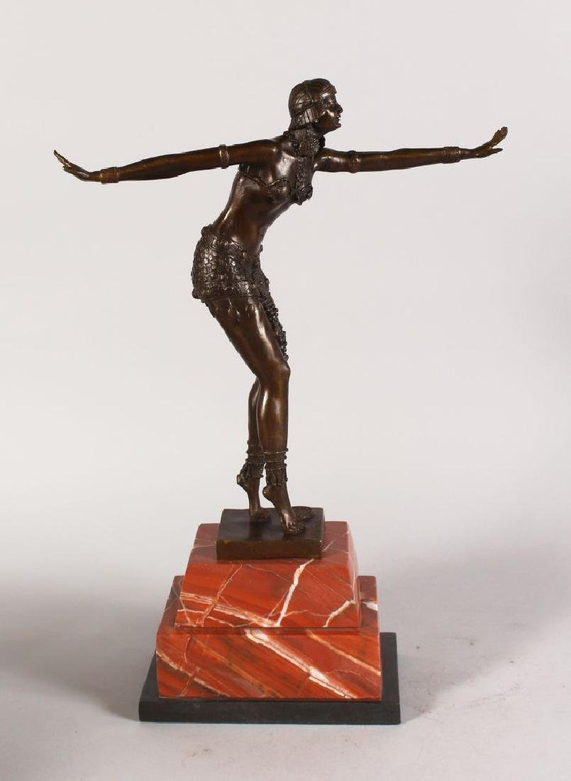 AN ART DECO STYLE BRONZE OF A DANCING LADY, on a