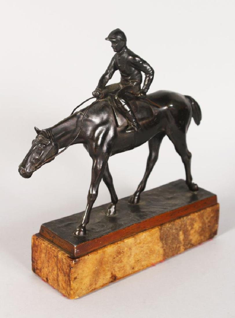 A GOOD BRONZE HORSE AND JOCKEY on a marble base.  10ins