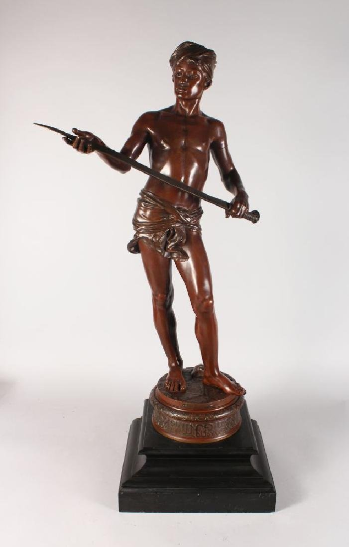 J. CAMBOS  A LARGE STANDING BRONZE OF A NUBIAN MAN