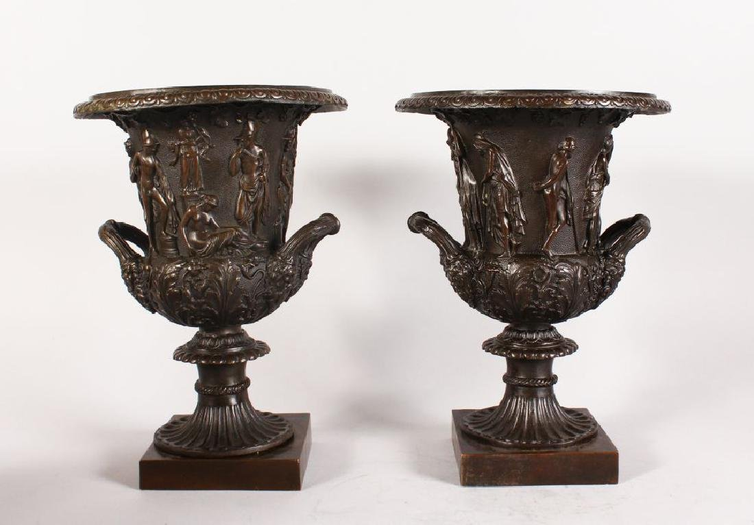 A GOOD PAIR OF BRONZE URNS, of campagna form, decorated