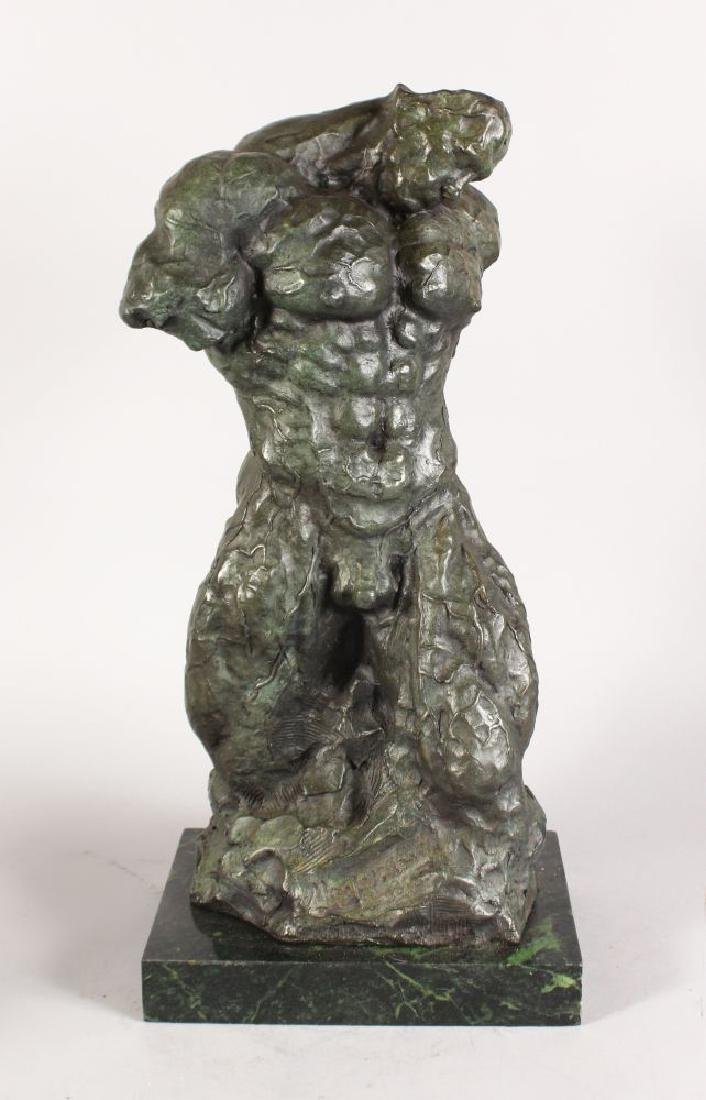 AN UNUSUAL ABSTRACT BRONZE FIGURE OF A MAN, on a