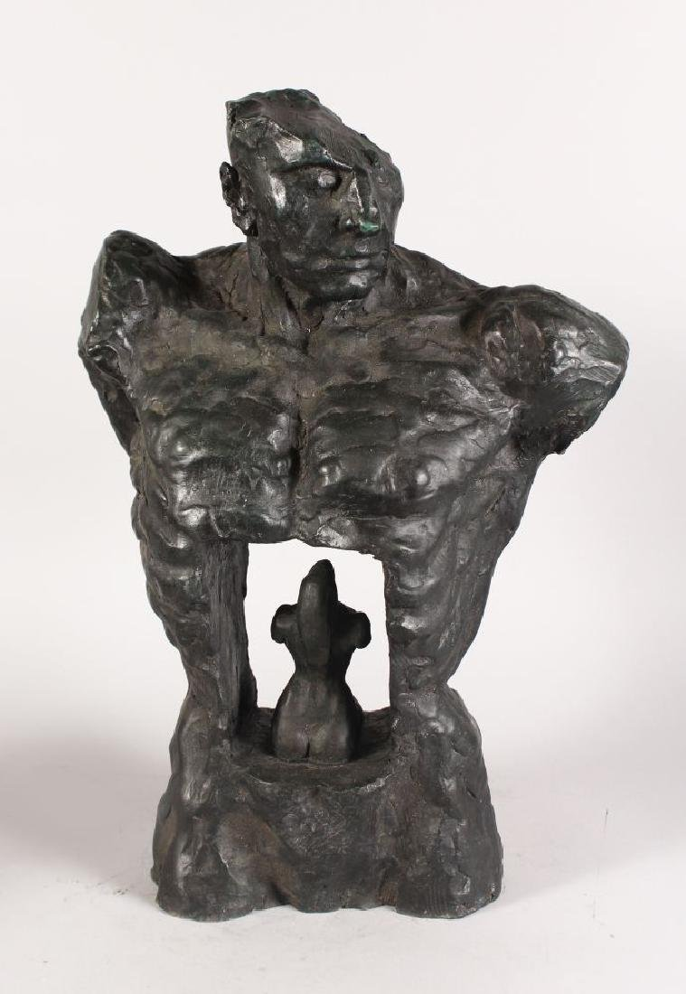 AN UNUSUAL ABSTRACT BRONZE TORSO OF A MAN.  1ft 10ins