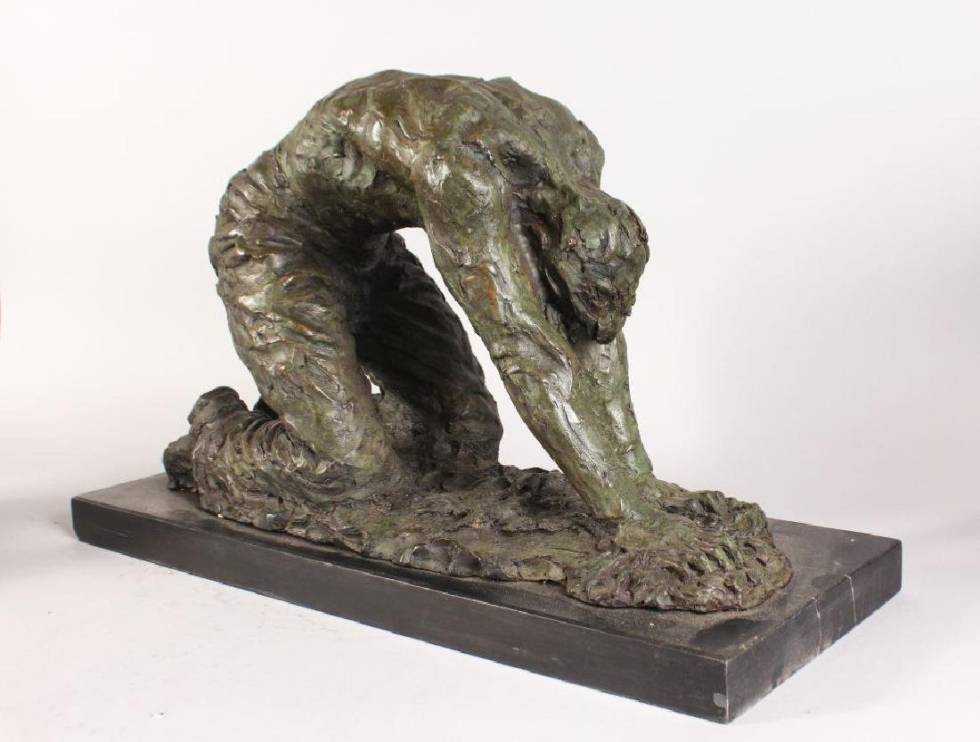 AN UNUSUAL ABSTRACT BRONZE FIGURE OF A KNEELING MAN, on